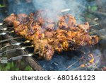 fried meat at the stake | Shutterstock . vector #680161123