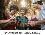 happy friends using mobile... | Shutterstock . vector #680258617