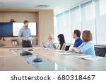 business people discussing at... | Shutterstock . vector #680318467