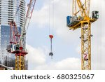 tower construction crane moves... | Shutterstock . vector #680325067