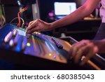in selective focus of woman dj... | Shutterstock . vector #680385043