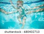 Little Boy Learning To Swim...