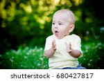 one year old baby on the grass  | Shutterstock . vector #680427817