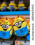Small photo of Osaka, Japan - MARCH 29 2016 : Photo of HAPPY MINION bags, selling Minion Goods shop. located in Universal Studios JAPAN, Osaka. Minions are famous character from Despicable Me animation.