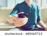 young man using tv remote... | Shutterstock . vector #680465713