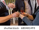 hands holding glasses and... | Shutterstock . vector #680481493