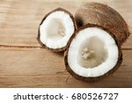 ripe coconut close up on wood... | Shutterstock . vector #680526727