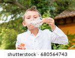 a caucasian kid with a white... | Shutterstock . vector #680564743