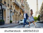 romantic couple running across... | Shutterstock . vector #680565313