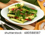 summer squash slaw in bowl at... | Shutterstock . vector #680588587
