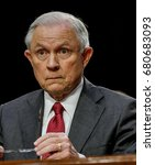 Small photo of US. Attorney General Jeff Sessions reads from prepared answers in response to a question from one of the members of the Senate Intelligence Committee during his testimony Washington DC, June 13, 2017.