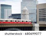 red train crossing long field... | Shutterstock . vector #680699077
