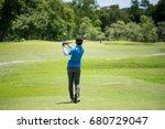 golfer swing hitting golf ball... | Shutterstock . vector #680729047