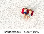 top view of couple lying on... | Shutterstock . vector #680741047