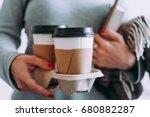 take away coffee seen in hands... | Shutterstock . vector #680882287