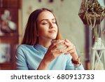 woman enjoying her cup of tea... | Shutterstock . vector #680913733