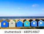 row of blue beach huts at... | Shutterstock . vector #680914867