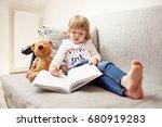 little cute girl reading a... | Shutterstock . vector #680919283