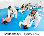 cheerful adults training in... | Shutterstock . vector #680926717