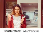 withdraw. happy woman holding... | Shutterstock . vector #680940913