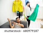 bored husband waiting for wife | Shutterstock . vector #680979187