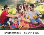 young people having picnic near ... | Shutterstock . vector #681441403