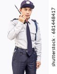 Small photo of Asian security guard isolated on white background,clipping path.