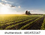 tractor spraying pesticides on...   Shutterstock . vector #681452167