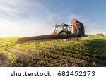 tractor spraying pesticides on... | Shutterstock . vector #681452173