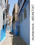 Small photo of Allay of Chefchaouen, Morocco, the striking, variously hued blue-washed old town. The Blue City of Morocco. Narrow colorful street in Chefchaouen. Public pedestrian street in Medina of Chefchaouen
