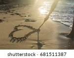 girl drawing a heart on the... | Shutterstock . vector #681511387