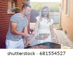 a man turns over a barbecue | Shutterstock . vector #681554527
