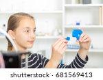 schoolgirl with 3d printe.... | Shutterstock . vector #681569413