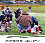CUMMING - OCTOBER 17: A young player down after a tackle on the field. October 17, 2009 in Forsyth County, Cumming, GA. Broncos vs Eagles. - stock photo