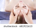 young woman lying on a massage... | Shutterstock . vector #681921613