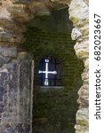 Small photo of An Arrow Slit in the wall of the 13th century Titchfield Abbey in Hampshire England that was home to a monastic community many centuries ago.