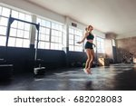 Young woman exercising using...