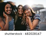 outdoor shot of three young... | Shutterstock . vector #682028167