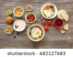 tasty breakfast with yogurt on... | Shutterstock . vector #682127683