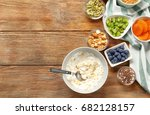 tasty breakfast with yogurt on... | Shutterstock . vector #682128157