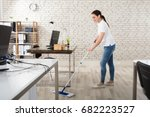 happy young woman cleaning the... | Shutterstock . vector #682223527