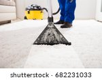Close Up Of A Janitor Cleaning...