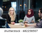 colleagues working overtime in... | Shutterstock . vector #682258507
