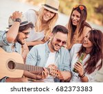 friends having fun at the beach ... | Shutterstock . vector #682373383