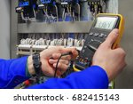 electrician measures voltage... | Shutterstock . vector #682415143