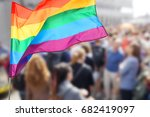 waving gay flag and crowd of... | Shutterstock . vector #682419097