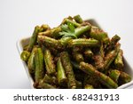 Small photo of Green beans Masala with spices, Indian vegetable recipe served in square bowl over colourful background, selective focusGreen beans Masala dry curry, Indian vegetable recipe served in square bowl over