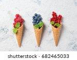 fresh berries in waffle cones... | Shutterstock . vector #682465033