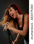 a young woman rock singer with...   Shutterstock . vector #682479283