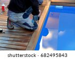worker making holes in the... | Shutterstock . vector #682495843